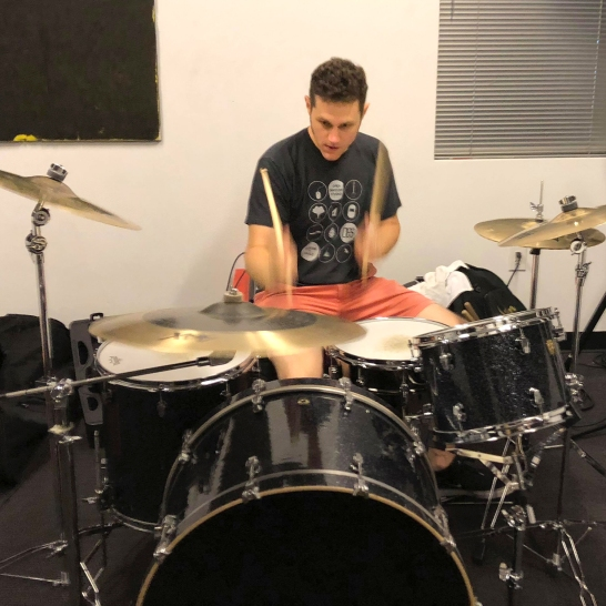 Ian playing drums during Ain't Nothins practice