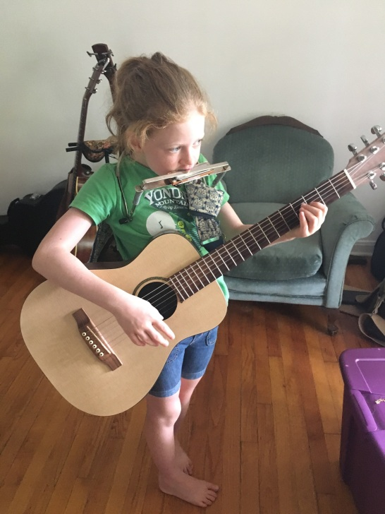 Lily, Mitch's daughter playing music
