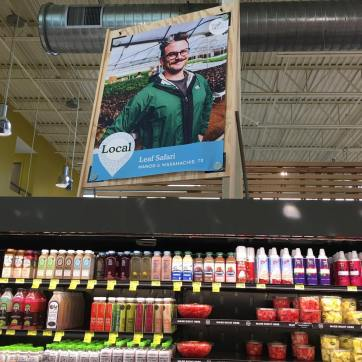 Sean on a banner at Whole Foods for Leaf Safari