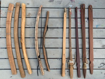 Neal Stilley's rabbit stick, friction fire bows, atlatl collection